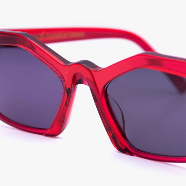 Sustainable red sunglasses bridge detail