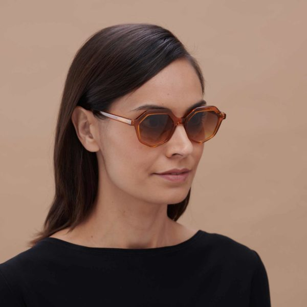 Girl wearing candy-colored sustainable designer sunglasses
